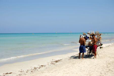 cuban people selling art at the tropical beach, varadero cuba