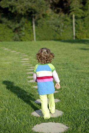 young person walking away, very independent youg girl  Stock Photo