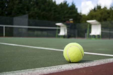 valid: tennis ball in the a tennis court, valid ball