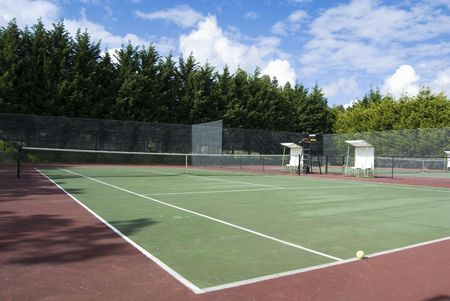 wide angle view of a tennis court and the referee chair