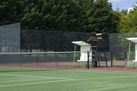 close angle of a tennis court and a referee chair