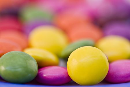 Close-up background of multi colored smarties candy photo