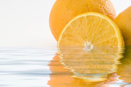 Orange isolated in a white background sorrounded by water  Stock Photo - 1016266