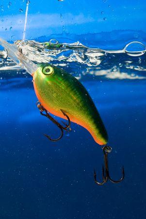 fishing bait underwater in a blue clear water
