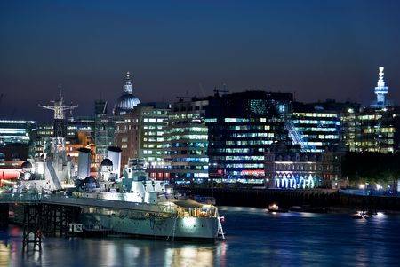 City on the riverside with a navy boat Stock Photo - 1905901