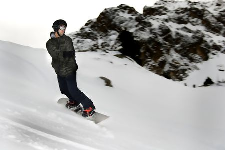 off track: youg mand snowboarding in the moutain off track Stock Photo