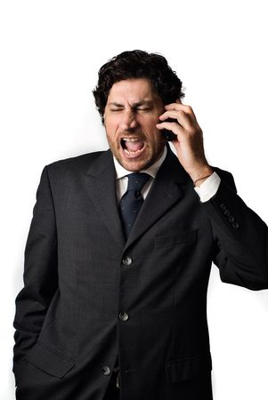 Angry business man yelling at mobile phone, white background
