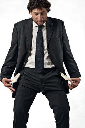 preoccupation: business man with empty pockets, concept of failure, moneyless, white background