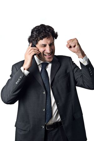 expression of a successful businessman talking on a mobile phone