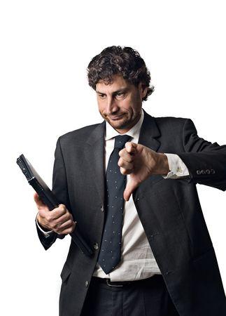 sad businessman, thumbs down whit laptop photo