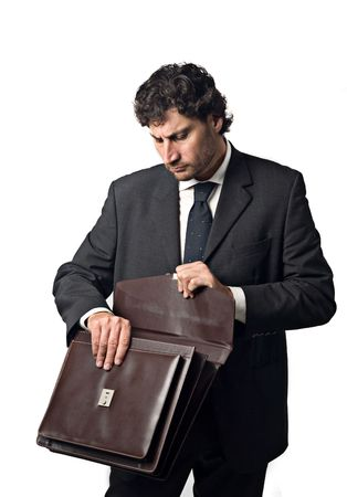 businessman searching for some paper in the suitcase Stock Photo