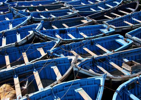 dinghies: blue fishing boats in morocco Stock Photo