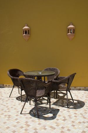 Coffe table with four rattan chairs Stock Photo