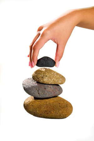 making a pile of stones with elegante hand Stock Photo