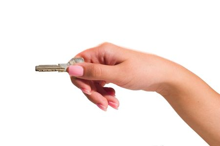 Elegant hand with a key - clipping paths photo