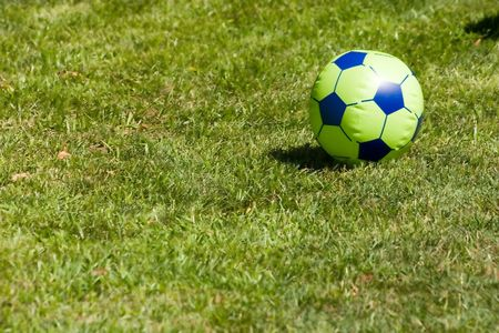 inflatable fotball ball in the grass