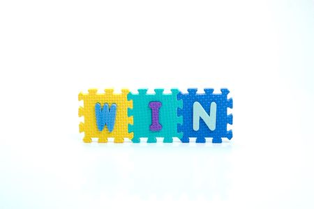 Colorful toy letters on spelling win isolated in white background Stock Photo - 1015592