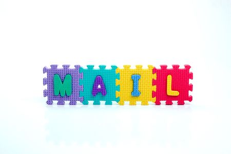 Colorful toy letters on spelling Mail isolated in white background photo