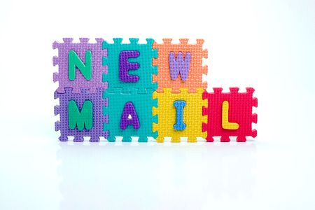 Colorful toy letters on spelling New Mail isolated in white background photo