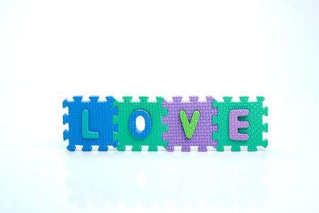 Colorful toy letters on spelling LOVE isolated in white background photo