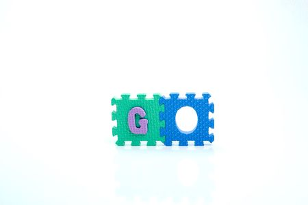 Colorful toy letters on spelling go isolated in white background photo