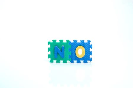 Colorful toy letters on spelling NO isolated in white background photo