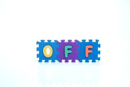 Colorful toy letters on spelling OFF isolated in white background