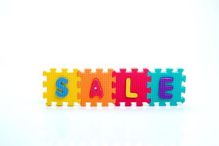 Colorful toy letters on spelling sale isolated in white background Stock Photo - 1015619