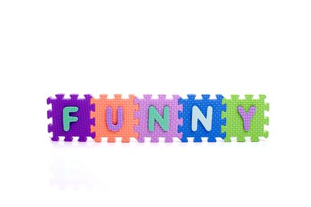 Colorful toy letters on spelling FUNNY isolated in white background
