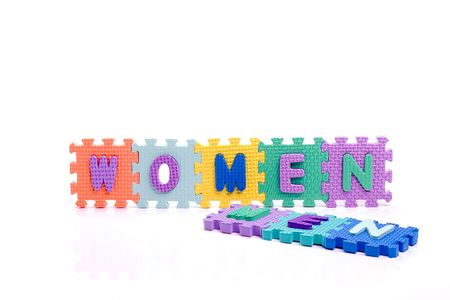 Colorful toy letters on spelling MEN and WOMEN isolated in white background Stock Photo