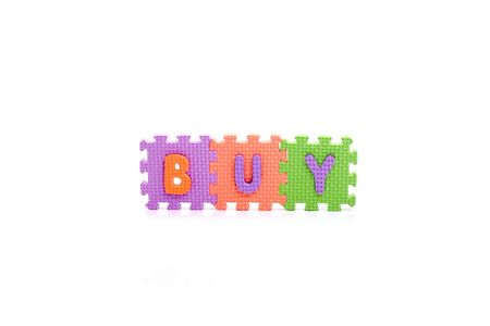 Colorful toy letters on spelling BUY isolated in white background