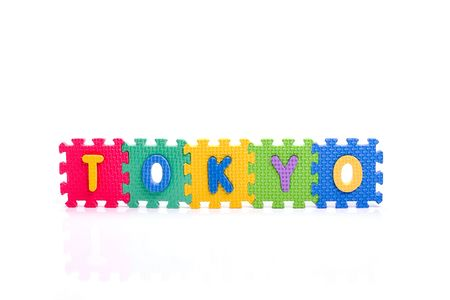 Colorful toy letters on spelling TOKYO isolated in white background
