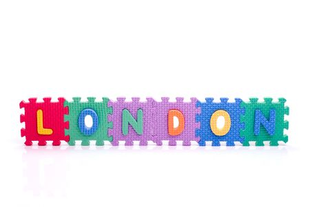 Colorful toy letters on spelling LONDON isolated in white background