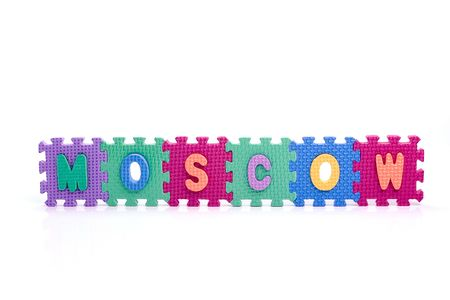 Colorful toy letters on spelling MOSCOW isolated in white background