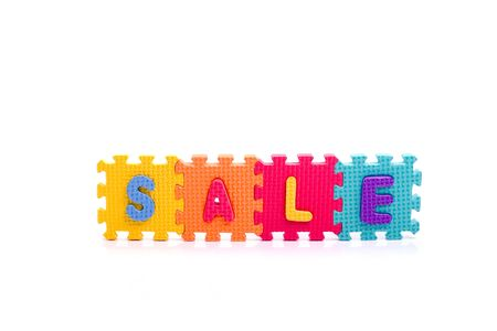 Colorful toy letters on spelling sale isolated in white background