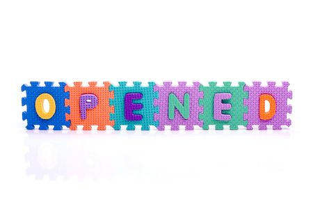 Colorful toy letters on spelling OPENED isolated in white background Stock Photo - 1063784