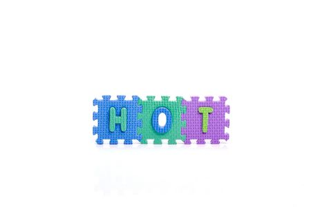 Colorful toy letters on spelling TOY isolated in white background photo
