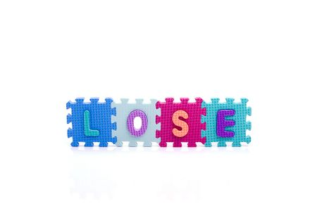 Colorful toy letters on spelling LOSE isolated in white background photo