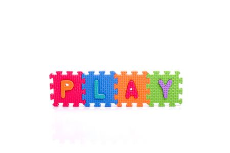 Colorful toy letters on spelling PLAY isolated in white background Stock Photo