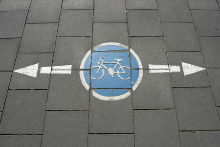 Cycling sign on the road with an arrow Stock Photo - 860524