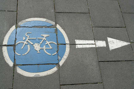 Cycling sign on the road with an arrow photo