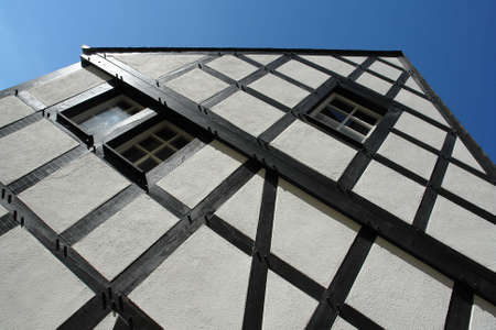 gable house: gable of a half-timbered house in black and white - in a traditional german village