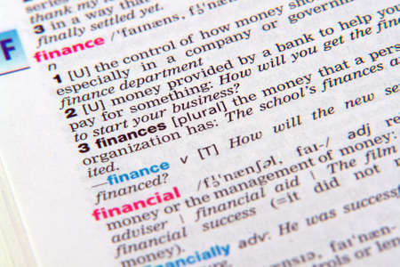 pronounce: Close up of the word finance out of the dictionary