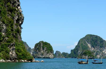 Small boats in Ha Long Bay Stock Photo