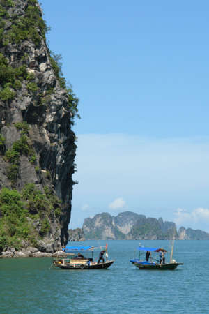 ha: Small boats in Ha Long Bay Stock Photo