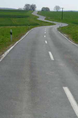 wide open spaces: Winding road in rural area with fields and wide open spaces