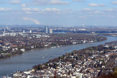 Bonn in the Rhine valley with a village and a container ship on the Rhine