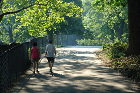 Elderly couple speed walking in Central Park new york city Stock Photo