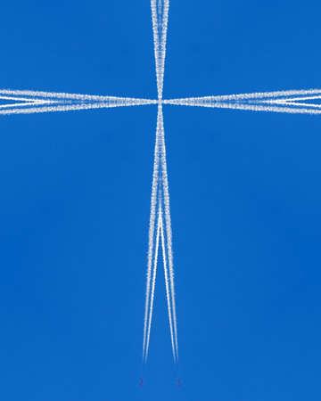 crux: kaleidoscope cross:  jet contrails on blue sky