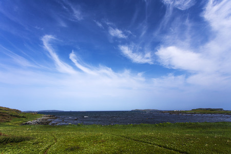 cirrus: cirrus clouds in blue sky over LAnse aux Meadows, Newfoundland